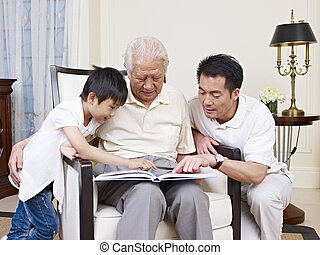 three generation family - asian son, father and grandfather...