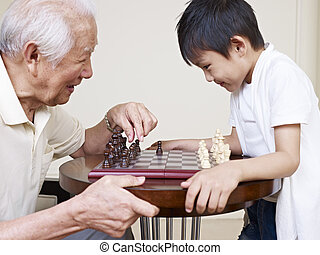 grandpa and grandson - asian grandpa and grandson playing...
