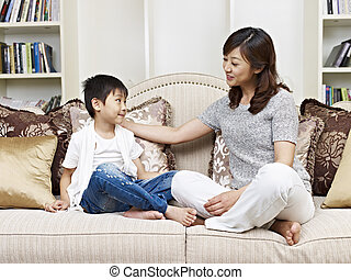 mother and son - asian mother and son having a conversation...
