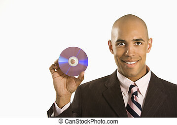 Man holding compact disc. - African American man smiling...