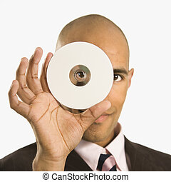 Man holding compact disc. - African American man holding...
