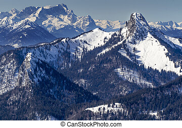 Plankenstein mountain in Bavaria in Winter with Zugspitze...