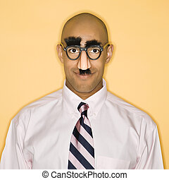 Man in disguise. - African American man wearing groucho mask...