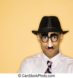 Man in disquise. - African American man wearing groucho mask...