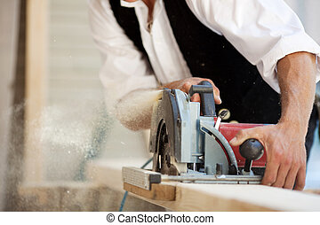 Carpenter with a circular saw - Close-up of a carpenter...