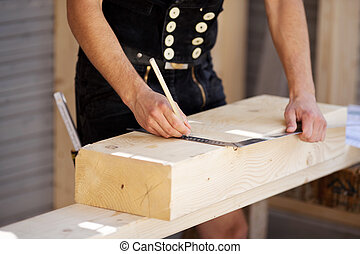 Carpenter with angle tool - Carpenter marks on wood with...