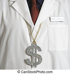 Doctor wearing dollar sign. - Close up of doctor wearing...