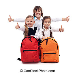 Back to school concept with happy kids giving thumbs up sign...