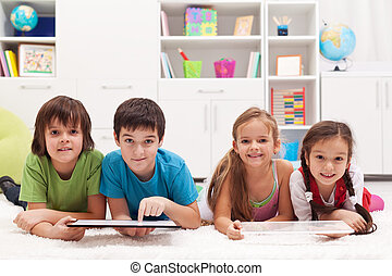 Happy kids with tablet computers