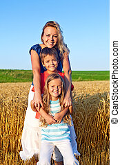 Happy family outdoors - In the summer sunshine- happy family...