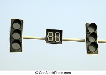 traffic signal lights in the blue sky