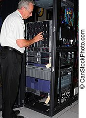 Computer Diagnosis - Man examining data processing machine...