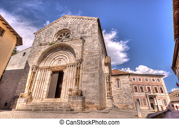 La collegiata 2 - The facade of a medieval baptistery in San...