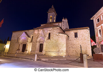 La collegiata night 2 - The facade of a medieval church in...