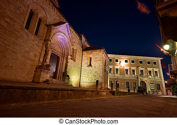 La collegiata night - The facade of the medieval church La
