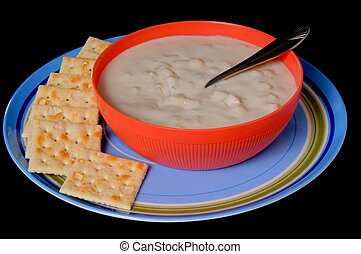 Clam Chowder - A steaming bowl of clam chowder with crackers...