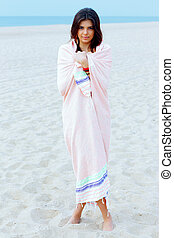 Young beautiful woman wrapped herself with blanket on the...