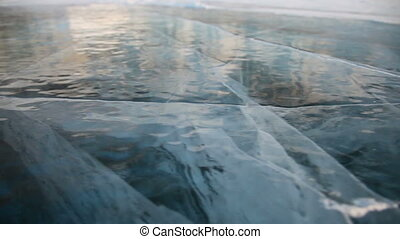Ice of Baikal lake - Shoot with slider using on Baikal lake...