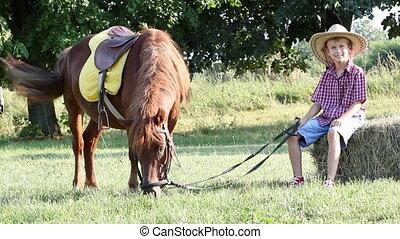 boy and pony horse on farm