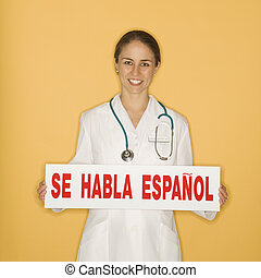 Doctor and Spanish sign. - Portrait of Caucasian mid-adult...