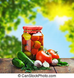 Canned vegetables and fresh against the backdrop of nature