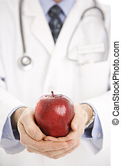 Doctor holding apple.