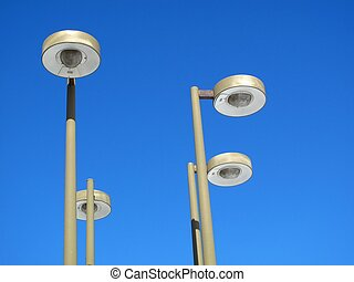 Light posts with a blue sky during the day