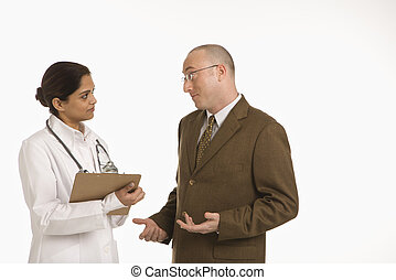 Woman doctor and businessman. - Indian mid adult woman...