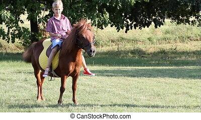 boy riding pony horse
