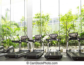 Gym - Four Treadmill in a gym with high ceiling in front of...