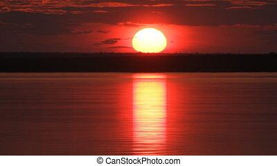 Sundown on river. - The Sundown sun on river.
