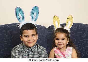 Kids wearing bunny ears - Hispanic brother and sister...