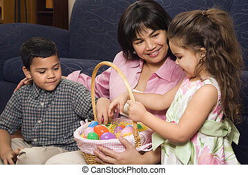 Family celebrating Easter - Hispanic mother with her boy and...