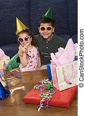Kids having birthday party - Hispanic brother and sister...
