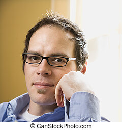 Man in glasses - Caucasian mid adult man wearing glasses and...