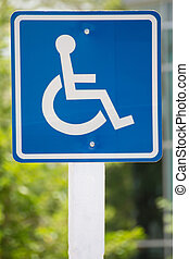 Wheelchair sign - Blue wheelchair sign on the post