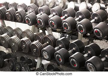 Dumbbells - A rack of dumbbells in a gym.