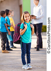 primary school student carrying backpack - happy primary...