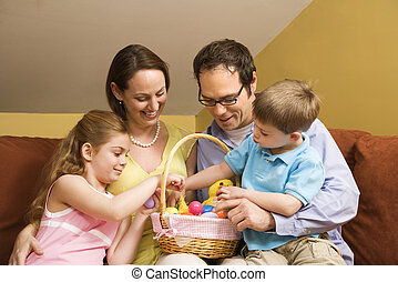 Family with Easter basket. - Caucasian family on couch...