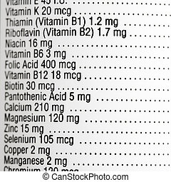 Nutritional label - Close up of supplement label with amount...