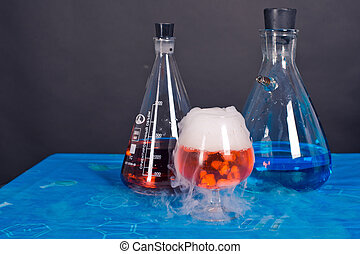 Flask and a glass of dry ice - Flask and a glass of dry ice...