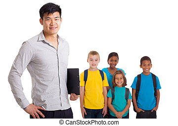 male teacher and young school kids - smiling male teacher...
