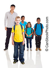 boy standing in front of classmates and teacher - cute...