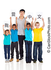 group of pupils learning chinese with teacher - group of...