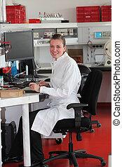 Confident female lab technician