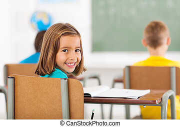 adorable little schoolgirl in classroom - cheerful adorable...