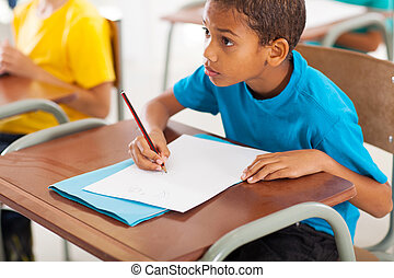 african American student studying Chinese in classroom -...