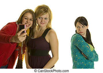 Mean Girls Take photos wi - Two girls take photos with cell...