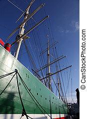 Hull and rigging of a tall ship - View along the hull of a...