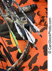 Bow and arrows. - Still life shot of bow and arrows laying...